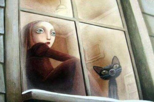 Οι τοξικές οικογένειες - Γυναίκα και γάτα κοιτούν έξω από το παράθυρο