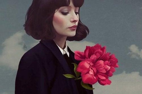 Γυναίκα με λουλούδι στο στήθος, μάθετε να είστε ευτυχισμένοι