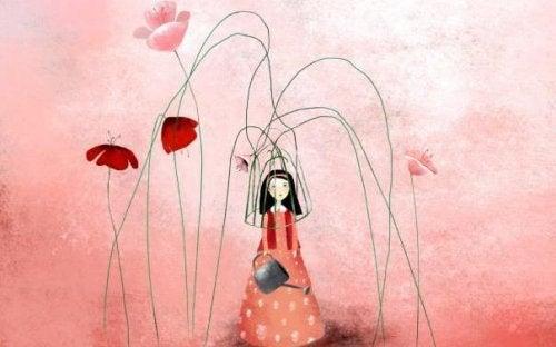Κοπέλα και κόκκινα λουλούδια