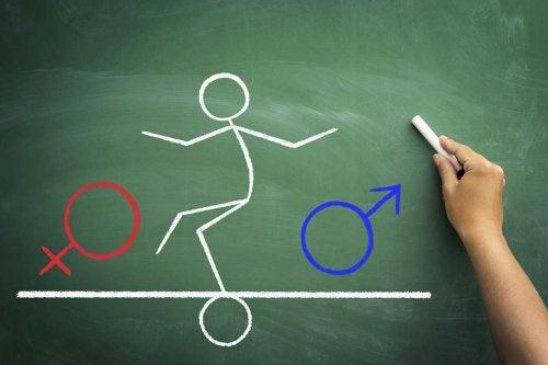 Ανθρωπάκι ισορροπεί ανάμεσα στο γυναικείο και το ανδρικό σύμβολο