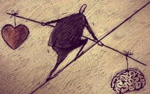 άνθρωπος που ισορροπεί κρατώντας από τη μια το μυαλό απο την άλλη την καρδιά
