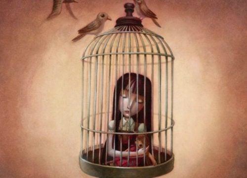 Συναισθηματικά πληγωμένο παιδί σε κλουβί