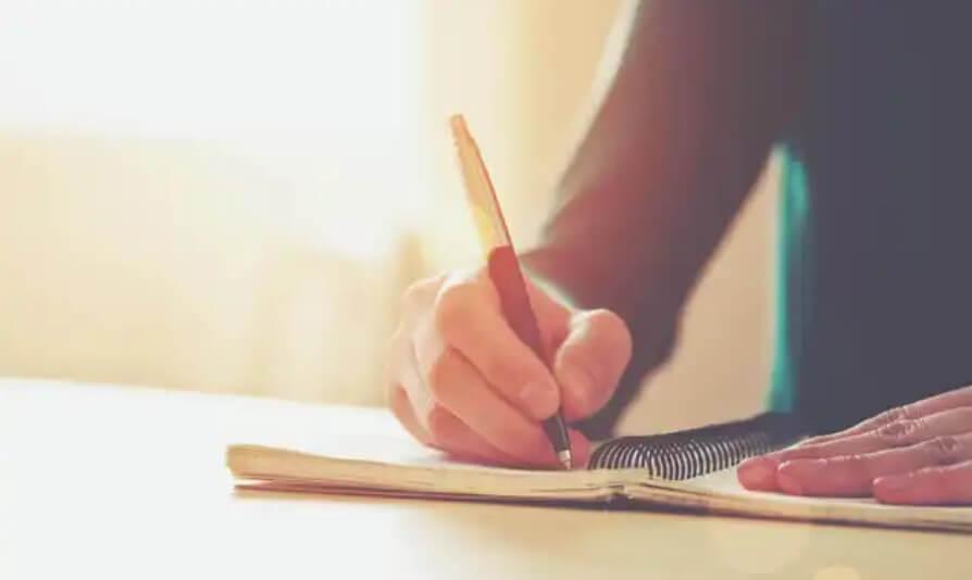 χέρι που γράφει